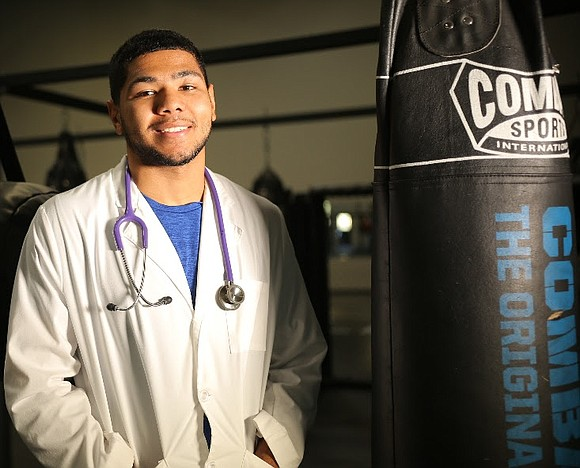 Darius Fulghum, a spring 2019 graduate of Prairie View A&M University's College of Nursing, is a boxer on a new ...