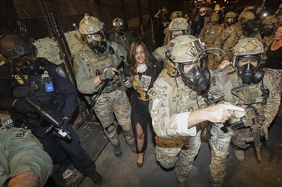 The U.S. agents repeatedly fired what appeared to be tear gas, flash bangs and pepper balls before dawn to clear ...