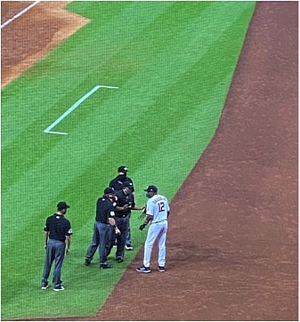 Astros manager Dusty Baker talks with the umpires after the benches were cleared