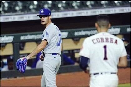 Astros player Carlos Correa walks after Dodgers pitcher Joe Kelly after they exchanged words.