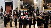 Members of the Congressional Black Caucus, bid farewell at the conclusion of a service Monday for the late Rep. John Lewis, D-Ga., a key figure in the Civil Rights Movement and a 17-term congressman from Georgia, as he lies in state at the U.S. Capitol in Washington.