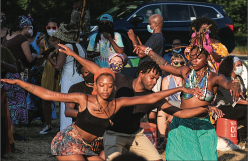 Members of the audience dance to the beat of the drums of the Drum Circle.