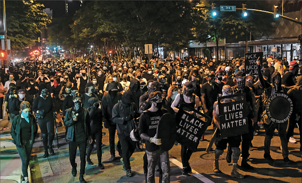 About 1,000 protesters marched through Richmond to show solidarity with demonstrators in Portland, Ore., where federal officers are using questionable force with those they detain or arrest.