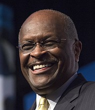 Herman Cain speaks during a Faith and Freedom Coalition event in 2014 in Washington, D.C.  Cain has died after battling the coronavirus.  (AP Photo)