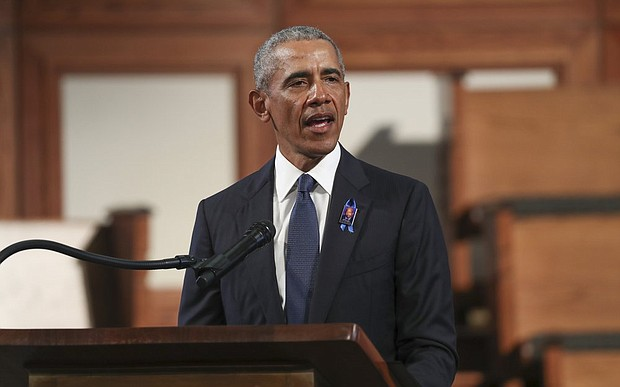 Former President Barack Obama addresses the service during the funeral for the late Rep. John Lewis, D-Ga., at Ebenezer Baptist Church in Atlanta, Thursday, July 30.  (Alyssa Pointer/Atlanta Journal-Constitution via AP, Pool)