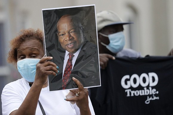 John Lewis was mourned, revered and celebrated as an American hero on Thursday at Atlanta's Ebenezer Baptist Church.
