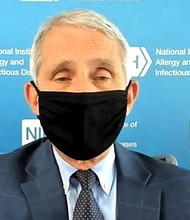 During a live interview with BlackPressUSA, Dr. Anthony Fauci, director of the National Institute of Allergy and Infectious Diseases and considered by many to be the nation's foremost infectious disease expert, demonstrates the proper way to wear a face mask.