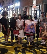Valarie Carey Reaves-Bey with mural supporters