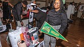 "KeAsia Jasper shows off her trunk filled with school supplies, including dorm room necessities, that will accompany her to George Mason University this fall. She was among 14 high school graduates honored with the gifts by the Richmond Redevelopment and Housing Authority on July 28 at its inaugural ""Open House in the Village."""