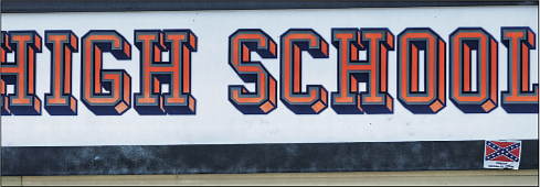 """A small sign bearing the Confederate battle flag and the words """"I Support Confederate Heritage"""" is posted on the Hanover high school's marquee."""