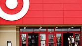 Shoppers wear face masks while leaving a Target store in Niles, Ill. Target announced that it will close its stores Thanksgiving Day as it continues to adjust amid the coronavirus pandemic.