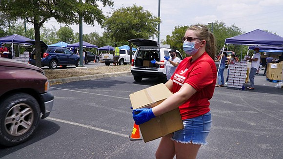 Wells Fargo parking lots become mobile food distribution centers this summer as the company teams with local food banks during ...