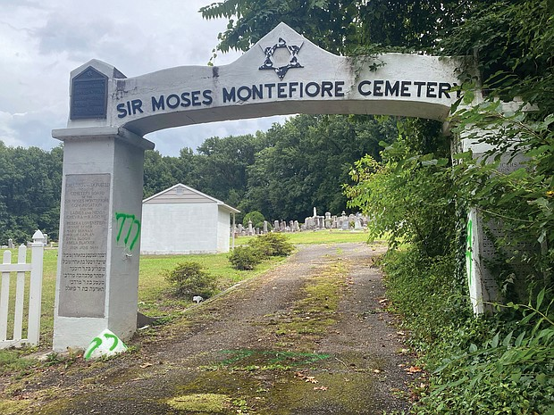 The entrance to Sir Moses Montefiore Cemetery, a Jewish cemetery started by immigrants in 1886 in Fulton, also bears graffiti linked to hate groups.