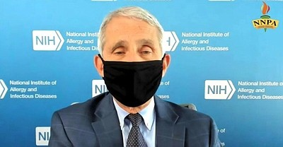 During a live interview with BlackPressUSA, Dr. Anthony Fauci, director of the National Institute of Allergy and Infectious Diseases, considered by many to be the nation's foremost infectious disease expert, demonstrates the proper way to wear a face mask