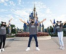 Disney Dreamers Academy alumni, from left, Gabrielle Wright, Anthony Juba-Richardson and Julia Shepherd pose for a photo in front of Cinderella Castle in Magic Kingdom Park at Walt Disney World Resort in Lake Buena Vista, Fla. On Aug. 6, 2020, Disney Dreamers Academy will hold a virtual event this fall and, for the first time in the program's history, offer career shadow externships for all 100 members of the class