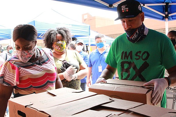 Bronx Borough Pres. Rubén Díaz Jr. hosted an event to distribute food and personal protective equipment at River Park Towers ...