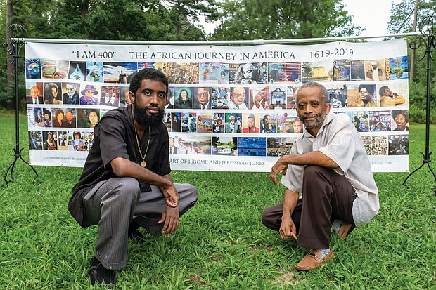 "Artists Jeromyah Jones, left, and his father, Jerome W. Jones Jr., display their ""I AM 400"" banner outside at Pine Camp Cultural Arts and Community Center. It shows many seminal events and people in African-American history during the last 400 years."