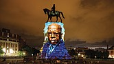 A picture of the late Congressman John Lewis of Georgia, a lion of the Civil Rights Movement, is projected onto the pedestal of Confederate Gen. Robert E. Lee's statue on Monument Avenue, reclaiming the space for the history and triumphs of African-Americans. the projection was done after Rep. Lewis' death on July 17.
