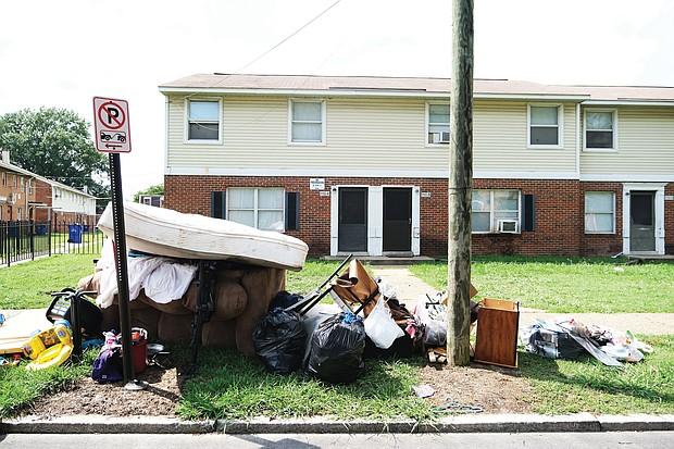 Piles of belongings like these outside a row of apartments in North Jackson Ward could become more common in Richmond and elsewhere. Evictions are predicted to skyrocket in coming months without government intervention to help millions of people struggling to pay rent as jobs and businesses have been lost during the pandemic.