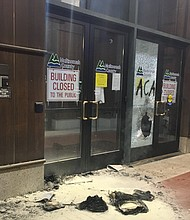 A photo shows some of the damage to the Multnomah County building in southeast Portland after fires were set and windows were broken out in a demonstration that started Tuesday night and ended with clashes with police. (Portland Police Bureau photo)