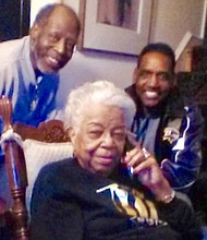 Former Walbrook High School principal Dr. Anne Emery (center), pictured at her home with Walbrook graduates Billy Harrington (left) and Wardell Woodrow Wilson, Jr. Dr. Emery, Harrington, and Wilson are all Tuskegee University alums. Dr. Emery, who founded Heritage United Church of Christ with her late husband, Vallen L. Emery Sr., died Wednesday, August 19, 2020. A native of Thomasville, Alabama, her illustrious career in education also included serving as vice principal of Lemmel Junior High School. Also called 'Mama Emery' by her former students, she was chartering president of the Baltimore Chapter of 100 Black Women and a member of the Baltimore City Commission for Women.