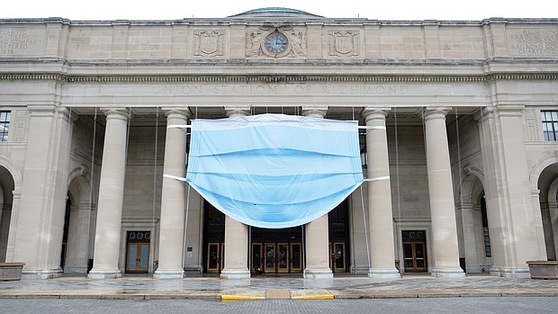 A giant symbol of the times now adorns the facade of the Science Museum of Virginia as it prepares to reopen to the public 9:30 a.m. Saturday, Sept. 5. The museum, at 2500 W. Broad St. near Downtown, has been closed to visitors for months because of the pandemic. The giant mask is a reminder that visitors will need to wear one to get in. The museum is one of many cultural spaces that are putting new requirements in place in moving from virtual events to actually welcoming visitors. In addition to the mask requirement, the museum will have visitors buy timed admission tickets in advance. It also will limit the number of people entering during operating hours. The museum currently is hosting the state Senate during the General Assembly's special session.