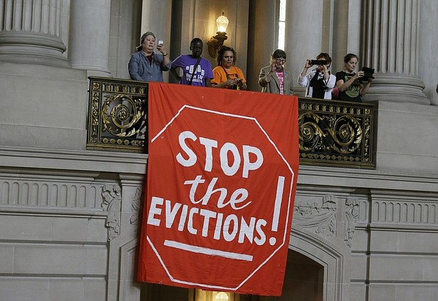 Demonstrators in San Francisco protest against evictions in an archive photo from AP. On Tuesday, Portland Mayor Ted Wheeler announced he is bringing forward new local housing relief measures to stabilize households facing eviction and foreclosure due to COVID-19.