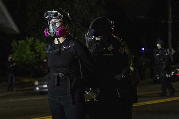 A Portland demonstrator is arrested during a Black Lives Matter protest on Aug. 30. Portland's Citizen Review Committee is now reviewing if police are using appropriate tactics for crowd control during protests and want to hear from the public who have experienced or witnessed crowd control tactics by Portland Police over the last three years, but especially within the last few months.  AP photo