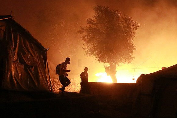Europe's largest migrant camp, Moria, has been devastated by massive fires that broke out early Wednesday at the overcrowded site ...