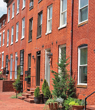 """The University of Maryland, Baltimore's """"Live Where You Work"""" program offers UMB employees assistance with down payments and closing costs on newly pur- chased homes in designated areas. Druid Heights and Heritage Crossing are newest neighborhoods added to the program."""