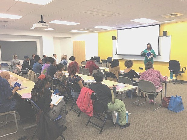 Sherry Curry, PNC Bank Harborside branch manager, teaching a class to entrepreneurs entitled 'Cash Flow'.