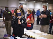 In response to massive wildfires across Oregon and near urban centers, Oregon Gov. Kate Brown tours the Oregon State Fairgrounds in Salem Saturday where she spoke with firefighting volunteers and evacuees.  (AP photo)