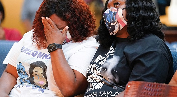 Tamika Palmer, the mother of Breonna Taylor, weeps during a news conference Tuesday announcing a $12 million civil settlement between the estate of Breonna Taylor and the City of Lousiville in Kentucky.