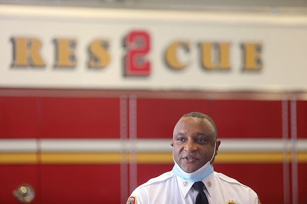 Richmond Fire Chief Melvin Carter delivers remarks during the city's commemoration last Friday, where the flag was lowered at Fire Station 10 on Hermitage Road. Firefighters from several stations stood at attention during the Pledge of Allegiance. Mayor Levar M. Stoney also spoke, while Police Chief Gerald M. Smith attended the event, which also was streamed online.