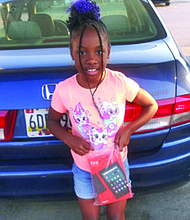 Eight-year-old Diamond is all smiles with her new tablet