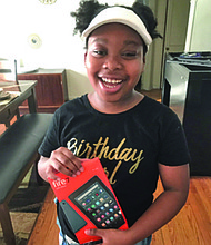 Ten-year-old Ariel is all smiles with her new tablet