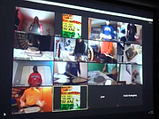 Students in Romeoville High School Music Teacher Adam Hill's class work on their drum techniques during a virtual lesson using the Zoom platform.
