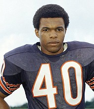 NFL Hall of Famer Gale Sayers is pictured in a 1970 file photo from AP.