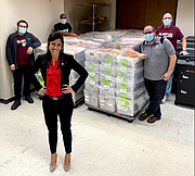 Will County Clerk stands in front of the more than 100,000 Vote-By-Mail ballots that were delivered Thursday to the U.S. Post Office in Joliet.