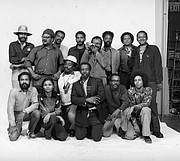 Henrico native Louis Draper, kneeling center, poses with fellow photographers in this Kamoinge group portrait from 1973 by Anthony Barboza.