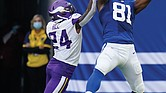 Indianapolis Colts tight end Mo Alie-Cox (81) makes a catch Sunday against the Minnesota Vikings' Holton Hill (24) during the second half of their game in Indianapolis.