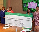 AKA International President and CEO Dr. Glenda Glover (first right) stands with sorority members with a donation check
