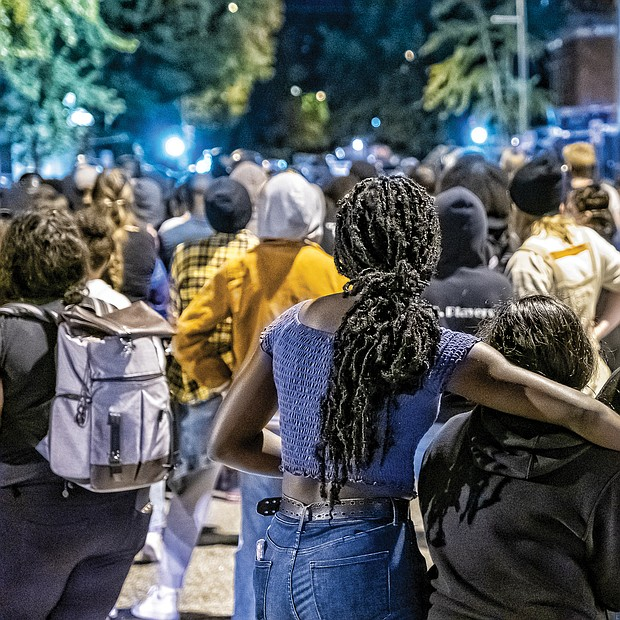 Local demonstrators marched from the area around the Lee statue on Monument Avenue, dubbed Marcus David Peters Circle, to Richmond Police Headquarters.