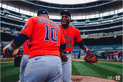 Pitcher Framber Valdez shares a moment with first baseman Yuli Gurriel after the win on Tuesday. Photo Credit/Houston Astros