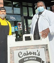 Journeyman butcher Theotis Cason (right) and his assistant Barry Williams welcome customers to Cason's Fine Meats, the Black-owned retail store for locally-sourced high quality meats and hard-to-find Southern staples. Casons is situated among other minority and women-owned businesses in the new Alberta Commons complex at Northeast Martin Luther King Jr. Boulevard and Alberta Street.