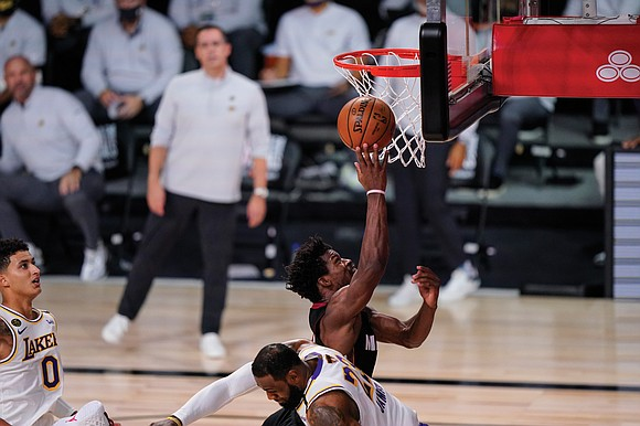 There will be a Game 5 Friday night, Oct. 9, in the NBA Finals. The Miami Heat's Jimmy Butler saw ...