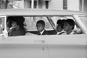Ben Chaney, center, in the car on the way to his brother's funeral, August 1964, Mississippi. Credit:Bill Eppridge/PBS