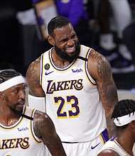 Los Angeles Lakers' LeBron James reacts during the first half in Game 6 of basketball's NBA Finals against the Miami Heat Sunday, Oct. 11, in Lake Buena Vista, Fla.  (AP photol)