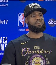 LeBron James celebrates with a cigar after leading the Los Angeles Lakers to the NBA title on Sunday night.