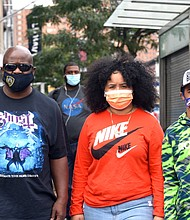 People wearing masks in Harlem to protect from COVID-19